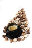 Zwarte koffiekop met schuim op chocolade. Royalty-vrije Stock Foto