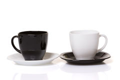 Zwarte kop op de witte plaat en witte kop op de zwarte plaat Stock Afbeelding