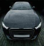 Zwarte krachtige sportwagen Royalty-vrije Stock Afbeeldingen