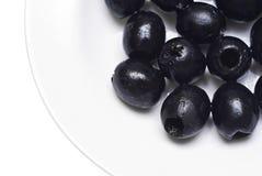 Zwarte kuiltjes gemaakte in olijven  Stock Afbeeldingen
