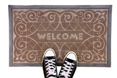 Zwarte laarzen en een tapijt   Stock Afbeelding