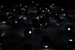 Zwarte lichte ballen op de vloer Stock Foto
