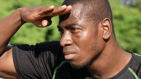 Zwarte Mannelijke Atleet Searching stock foto
