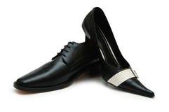 Zwarte mannelijke en vrouwelijke schoenen Stock Foto