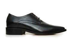 Zwarte mannelijke schoenen die op de witte achtergrond worden geïsoleerdC royalty-vrije stock foto