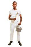 Zwarte mens als schilder met borstel stock foto