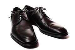 Zwarte mensenschoenen die op wit worden geïsoleerdb Royalty-vrije Stock Fotografie