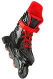 Zwarte met rode geïsoleerdek rollerskates. Royalty-vrije Stock Fotografie