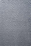 Zwarte metaalplaat met hobbelige oppervlakte royalty-vrije stock afbeelding