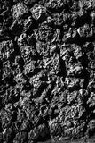 Zwarte metselwerkachtergrond Bruin decoratief pleister Royalty-vrije Stock Fotografie