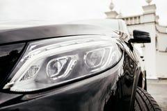 Zwarte moderne autokoplampen met bekleding stock fotografie