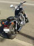 Zwarte motorfiets Stock Foto's