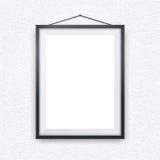 Zwarte omlijsting op een muur Stock Fotografie