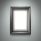 Zwarte omlijsting op grijze muur Stock Foto