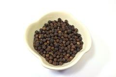 Zwarte peper in een kom Royalty-vrije Stock Afbeelding