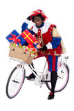 Zwarte Piet on a bike with presents Stock Image
