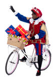 Zwarte Piet on a bike with presents Royalty Free Stock Photo