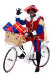 Zwarte Piet on a bike with presents Royalty Free Stock Images