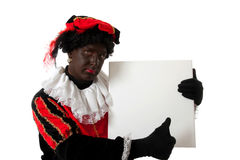 Zwarte Piet ( black pete). Typical Dutch character part of a traditional event celebrating the birthday of  Sinterklaas in december over white background is Royalty Free Stock Images