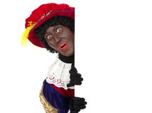Zwarte piet (black pete). Zwarte piet ( black pete) typical Dutch character part of a traditional event celebrating the birthday of Sinterklaas in december over Stock Image