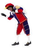 Zwarte piet (black pete). Zwarte piet ( black pete) typical Dutch character part of a traditional event celebrating the birthday of Sinterklaas in december over Royalty Free Stock Photography