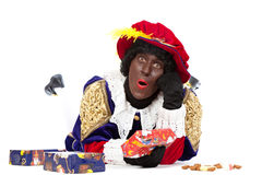 Zwarte piet (black pete). Zwarte piet ( black pete) typical Dutch character part of a traditional event celebrating the birthday of Sinterklaas in december over Royalty Free Stock Images