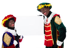 Zwarte piet (black pete). Zwarte piet ( black pete) typical Dutch character part of a traditional event celebrating the birthday of Sinterklaas in december over Stock Photo