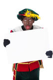 Zwarte piet (black pete). Zwarte piet ( black pete) typical Dutch character part of a traditional event celebrating the birthday of Sinterklaas in december over Stock Photos