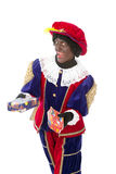 Zwarte piet (black pete). Zwarte piet ( black pete) typical Dutch character part of a traditional event celebrating the birthday of Sinterklaas in december over Stock Images