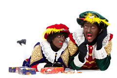 Zwarte piet (black pete). Zwarte piet ( black pete) typical Dutch character part of a traditional event celebrating the birthday of Sinterklaas in december over Royalty Free Stock Image