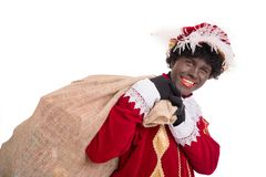 Zwarte Piet or Black Pete with burlap sack full of presents. Si royalty free stock photography