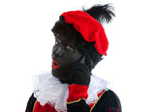 Zwarte piet ( black pete) with mobile phone. Zwarte piet ( black pete) typical Dutch character part of a traditional event celebrating the birthday of Stock Images