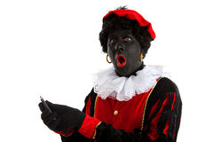 Zwarte piet ( black pete) with mobile phone Stock Photo