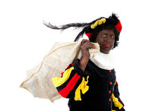 Zwarte piet ( black pete) typical Dutch. Character part of a traditional event celebrating the birthday of Sinterklaas in december over white background Royalty Free Stock Photos