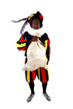 Zwarte piet ( black pete) typical Dutch. Character part of a traditional event celebrating the birthday of Sinterklaas in december over white background with Stock Images