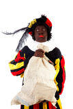 Zwarte piet ( black pete) typical Dutch. Character part of a traditional event celebrating the birthday of Sinterklaas in december over white background with Stock Photography