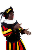 Zwarte piet ( black pete) typical Dutch. Character part of a traditional event celebrating the birthday of Sinterklaas in december over white background is Stock Photo