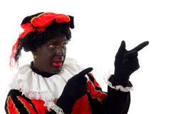 Zwarte Piet ( black pete) typical dutch character. Part of a traditional event celebrating the birthday of Sinterklaas in december over white background royalty free stock photography