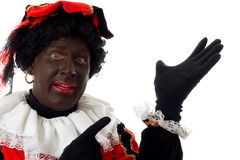 Zwarte Piet ( black pete) typical dutch character. Part of a traditional event celebrating the birthday of  Sinterklaas in december over white background Stock Photography