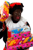 Zwarte Piet ( black pete) typical dutch character. Part of a traditional event celebrating the birthday of Sinterklaas in december over white background holding stock photos