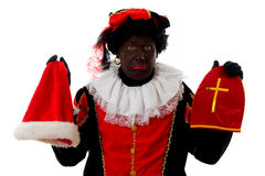 Zwarte Piet ( black pete) typical dutch character. Part of a traditional event celebrating the birthday of  Sinterklaas in december over white background Stock Image