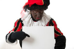 Zwarte piet ( black pete) typical Dutch character. Part of a traditional event celebrating the birthday of Sinterklaas in december over white background is Royalty Free Stock Image