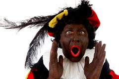 Zwarte piet ( black pete) typical Dutch character. Part of a traditional event celebrating the birthday of Sinterklaas in december over white background Royalty Free Stock Photo
