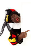 Zwarte piet ( black pete) typical Dutch character. Part of a traditional event celebrating the birthday of Sinterklaas in december over white background with Royalty Free Stock Images