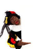 Zwarte piet ( black pete) typical Dutch character. Part of a traditional event celebrating the birthday of Sinterklaas in december over white background is Royalty Free Stock Images