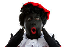 Zwarte piet ( black pete) typical Dutch character. Part of a traditional event celebrating the birthday of Sinterklaas in december over white background is Royalty Free Stock Photo