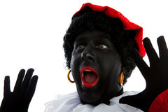 Zwarte piet ( black pete) typical Dutch character. Part of a traditional event celebrating the birthday of Sinterklaas in december over white background is Royalty Free Stock Photography