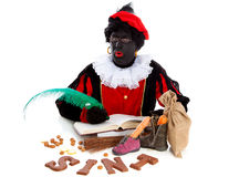 Zwarte piet ( black pete) typical Dutch character. Part of a traditional event celebrating the birthday of Sinterklaas in december over white background Stock Images