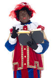 Zwarte Piet and the book of Sinterklaas Royalty Free Stock Images