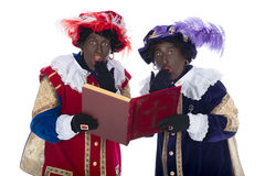 Zwarte Piet and the book of Sinterklaas Royalty Free Stock Photos